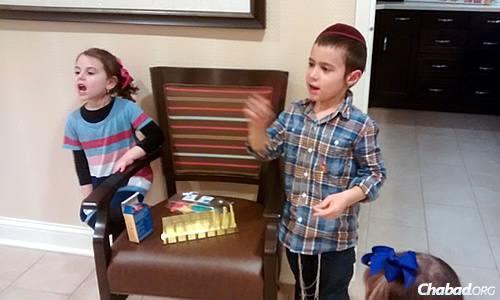 The kids came supplied with a box of chocolate coins, a tin menorah and some colorful Chanukah-shaped cookies.