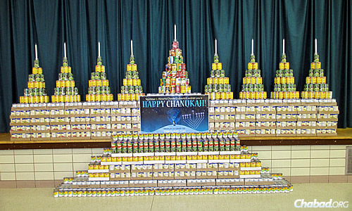 A can menorah in a previous year; the food was later given out to those in need.