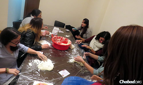 Women make challah and get to know one another in a casual setting.