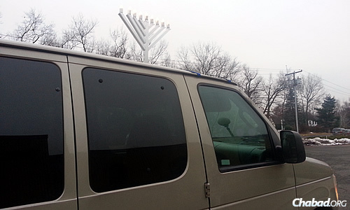 This car menorah was what Yoni Walz saw when he was lost in suburban Connecticut; in fact, it led him to a place to stay for Shabbat during Chanukah.