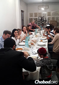 Guests partake in the meal before the start of Yom Kippur, the Jewish Day of Atonement and a fast day.