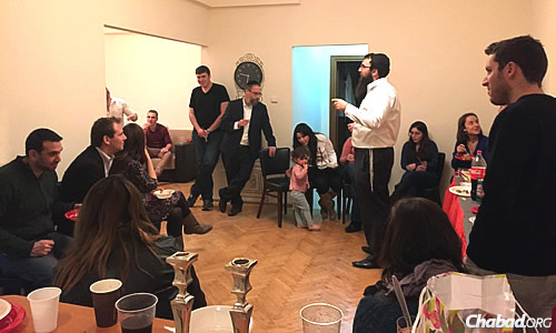 Rabbi Orgad hosts a birthday party for one of the students, typical of the intimate kinds of get-togethers they are fostering at first.