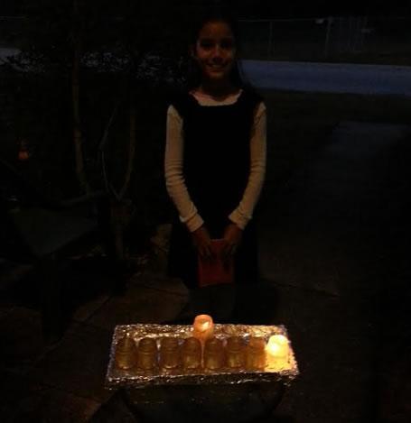 Olivia Miriam with her menorah