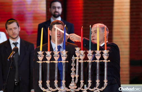 The contest was attended by Israel's Prime Minister Benjamin Netanyahu, a host of dignitaries from Israel and the Jewish world, and thousands of others. Here, the prime minister lights the menorah on the last night of Chanukah. (Photo: Yonatan Sindel/Flash90)