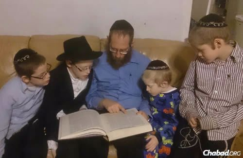 Studying Torah with his children.