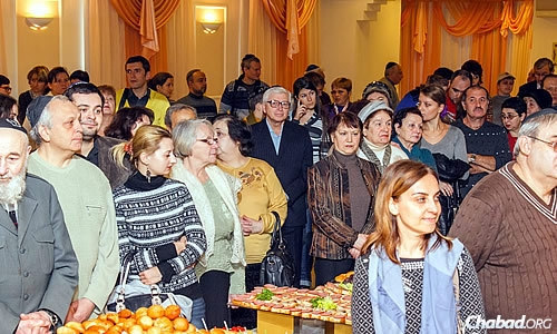 For the first time in two decades, no public Chanukah celebration took place this year in the center of Donetsk, Ukraine. But some 400 people emerged from their homes to gather in the city's Jewish community center to celebrate, with a large menorah illuminating the social hall.