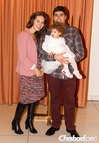 A young family attends the Chanukah event in the Donetsk Jewish community center.