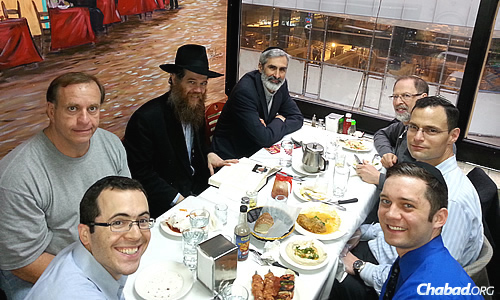 Rabbi Chayim B. Alevsky, co-director of family and youth programs at Chabad of the West Side in New York City, runs weekly Torah lunches at a kosher restaurant in Midtown Manhattan.