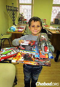 A boy in the after-school program at the Jewish community center in Mariupol receives a toy for Chanukah.