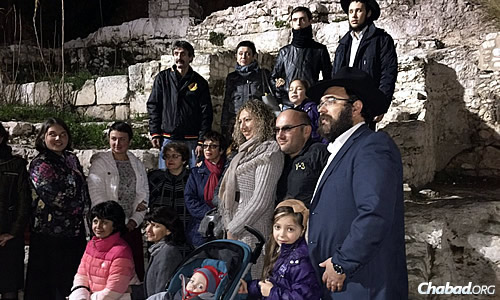 Gopin and his family, who for the time being have moved to Kfar Chabad, Israel, shuttle back and forth to meet the needs of those in Lugansk. Here, they get together with fellow Ukrainians in Jerusalem over the holiday.