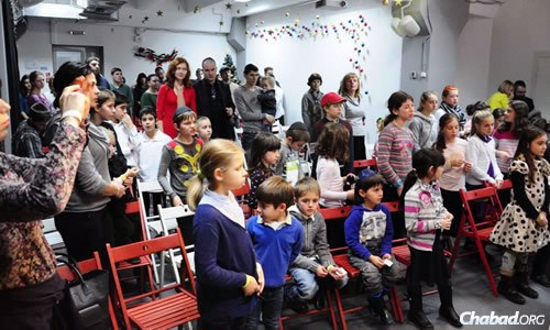 Children visit a science museum in Kiev as part of a Chanukah event for Donetsk Jews; here, they watch a menorah-lighting.