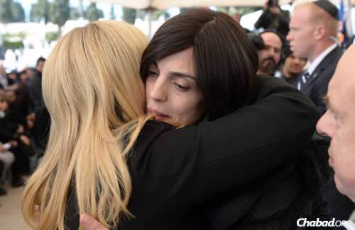 """Valerie Braham, center, the widow of Philippe Braham, is comforted by a friend. She broke down in tears eulogizing her husband, after noting that he was """"perfect"""" and """"lived for his family."""" (Photo: Haim Zach/GPO/Flash90)"""