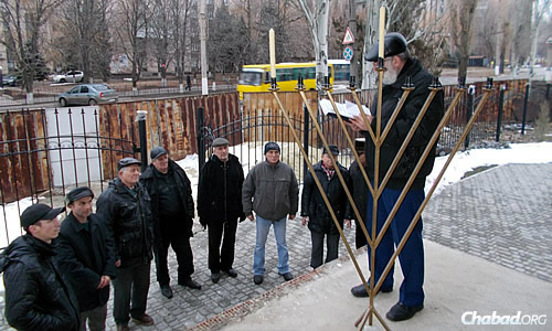 An outdoor menorah was lit in Lugansk in the backdrop of a city struggling under war.