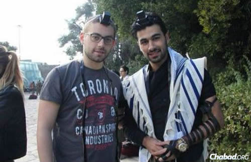 Yoav Hattab, right, with a friend.