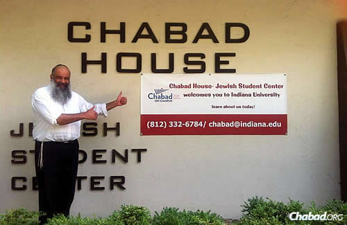 "Rabbi Yehoshua Chincholker, co-director of the Indiana University Chabad House-Jewish Student Center in Bloomington, Ind., in front of the campus Chabad center; he and his wife, Zlata, are sponsoring a ""Paris Shabbat"" for students this week in solidarity with the Jews of France."