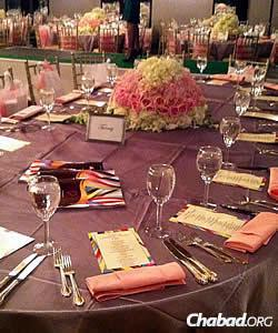 The tables reflected pink, the official color associated with breast-cancer awareness.