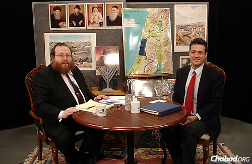 Mark Langfen, right, uses a three-dimensional display on Katzman's show to discuss water issues in Israel.