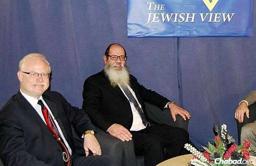 "Rabbi Nachman Simon, right, of the Chabad House of Delmar in Upstate New York, has been hosting ""The Jewish View"" on cable TV since 1987. Next to him is co-host Marc Gronich of Statewide News Service."