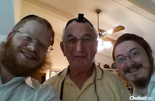 The two rabbis have made man connections during their time in South Dakota. Here, they pose with Herschel Preamak in the city of Aberdeen.