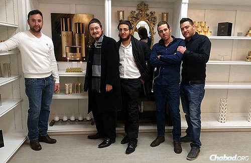 Sharfstein, second from left, and Druk, to his right, also held a menorah-lighting in the Sioux Falls Empire Mall, attended by this group of young men.