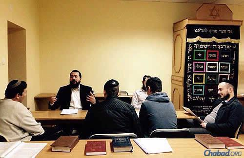 Cohen, who travels back and forth from Ukraine to Israel, where his family resides right now, teaches a class to Jewish residents dealing with volatile living conditions.
