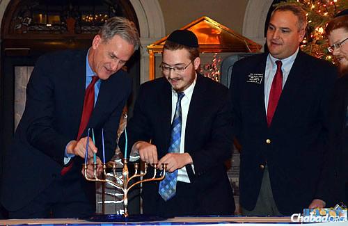 Inside the Capitol that same year, Sharfstein and Lefkowitz light the menorah with South Dakota Gov. Dennis Daugaard, left, and State Sen. Dan Lederman. (Photo: Joel Ebert-Capital Journal)