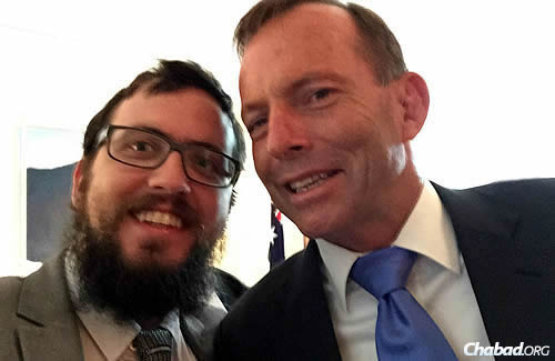 Even leaders take the occasional selfie ... Rabbi Shmuel Feldman and Abbott. (Photo: Sithu Tin-Aung)