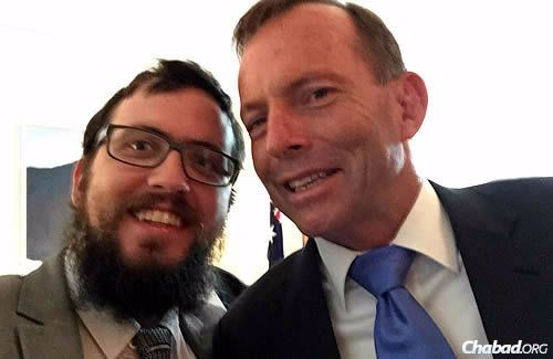 Even leaders take the occasional selfie ... Rabbi Shmuel Feldman and Abbott. (Photo: Sithu Tin-Aung)
