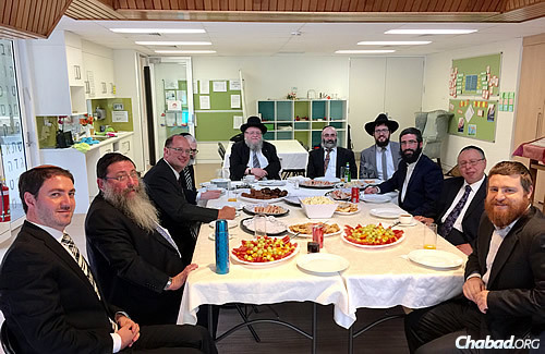 The rabbis gather for lunch at Chabad ACT headquarters, taking the opportunity to discuss halachic issues facing their respective communities. (Photo: Sithu Tin-Aung)