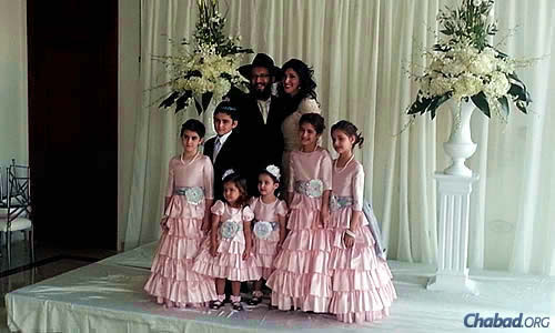 Rabbi Yossi and Dina Eber, co-directors of the Chabad Jewish Center of West Pasco in Trinity, Fla., and their six children. Eber and her 10-year-old twin daughters are flying to New York for the conference.