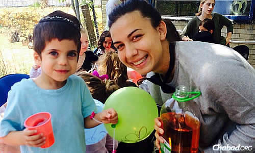 Yael Newman supervises activities—and serves up cold drinks to campers.