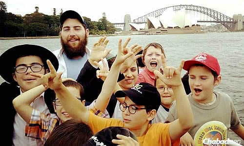 More than 100 boys and girls just completed two weeks of Gan Izzy Day Camp, run by Chabad Youth NSW in Australia. Here, boys take a boat ride, with the Sydney Opera House in the background.