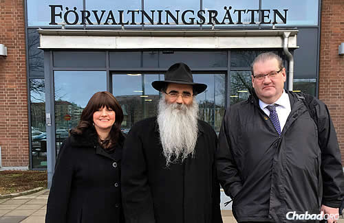 Rabbi Alexander and Leah Namdar, co-directors of Chabad-Lubavitch of Sweden, with their lawyer, Ulf Tollhage of the Nordia Law Firm. The couple has been involved in an ongoing legal battle for the right to homeschool their four youngest children.