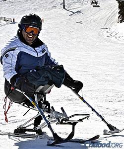 Loau Mrai, an Israeli Druze who participated in Golshim L'Chaim's 2012 class, uses a mono-ski with outriggers to control his descent. (Photo: Nina Zale/JTA)