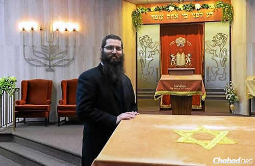 Assistant Rabbi Avrohom Boruch Itkin in the sanctuary of Congregation Agudas Achim in Kingston, N.Y., which is celebrating its 150th anniversary at a March 8 dinner event. (Photo: Tania Barricklo/ The Daily Freeman)