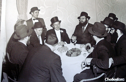 The rabbi, center in back, conversing with others at a wedding.