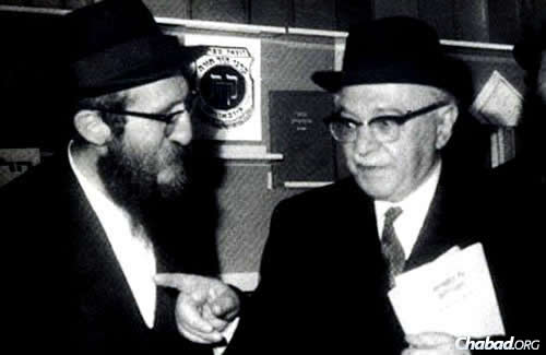 The rabbi with Zalman Shazar, former president of Israel, who hailed from a Chabad background, and who was a writer and scholar in his own right.