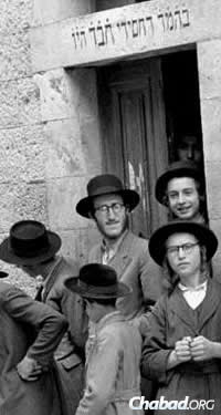 Glitzenshtein, top center, at the entrance to the Chabad synagogue in the Mea Shearim neighborhood of Jerusalem.