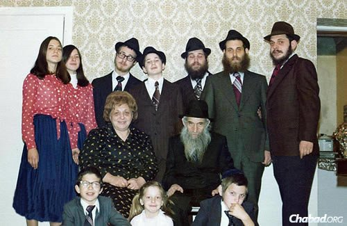 Devora Wilhelm, standing upper left, now co-director of Chabad Lubavitch of Oregon in Portland, with members of her family in Los Angeles in 1975. Delivering shmurah matzah was a big part of her childhood, encouraged by her parents, Rabbi Shmuel Dovid and Leah Raichik, shluchim to California. Her own son plans to hand out shmurah matzah at his upcoming bar mitzvah right before Passover.