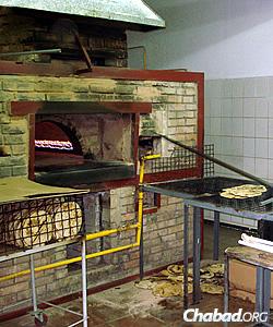 Baking shmurah matzah in Ukraine for distribution around the world.