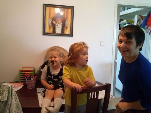 A doting grandmother with her smiling grandchildren