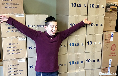 Mishulovin's son and Wilhelm's grandson, Shmuel Dovid (named for Devora Wilhelm's father), displays boxes and boxes of shmurah matzah at the store his father runs in Portland, Ore.