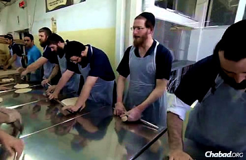 Rolling the dough for shmurah matzah at the historic bakery in Kfar Chabad, Israel.