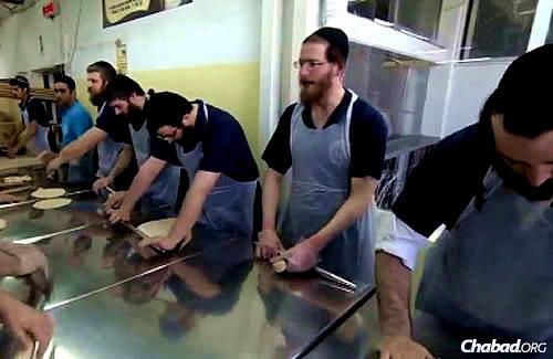 Rolling the dough for shmurah matzah at the historic bakery in Kfar Chabad, Israel.