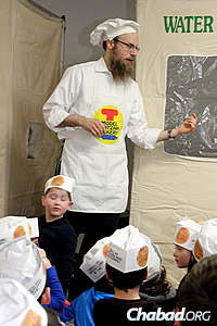 Rosenblum tells the Exodus story and then gets down to the business of helping kids make matzah. (Photo: Levi Grossbaum)
