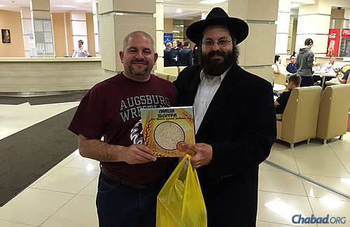 Minnesota native David Nathanson, who's on the U.S. curling team, gets some shmurah matzah for Passover.