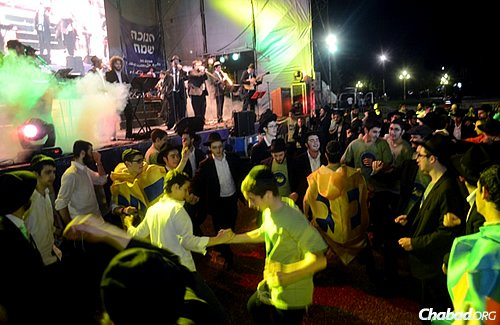 Boys dance to music at a celebratory bash this past Chanukah, which marked 30 years since the first public menorah was put up and lit in Argentina, initiated by Rabbi Grunblatt.