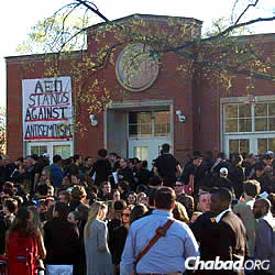 Students, faculty and school administrators gather in front of Alpha Epsilon Pi on March 30 for a rally against anti-Semitism, prompted after the painting of three swastikas on the walls of the Jewish fraternity house.