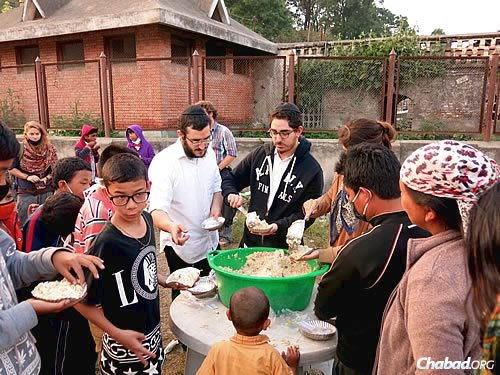 To help their neighbors on day five of the disaster in Nepal caused by a massive earthquake, the Chabad House in Kathmandu set up a food stall on Wednesday in a particularly impoverished area and began handing out food to anyone who was there. (Photo: David Karsenty/Chabad of Nepal)
