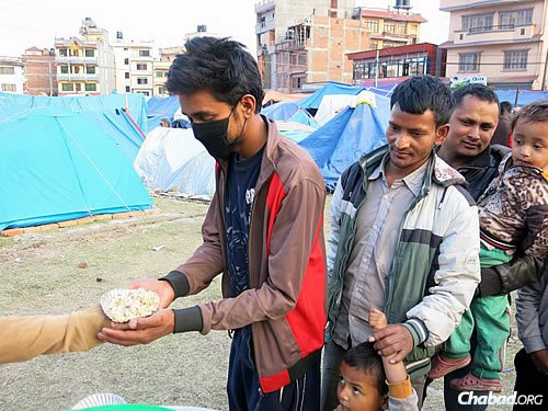 The sheer joy on people's faces as they took the food was infectious, describes those close to the situation. (Photo: David Karsenty/Chabad of Nepal)
